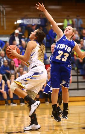 11-10-16<br /> Tri Central vs Tipton girls basketball<br /> Tri Central's Sarah Quesada looks to the basket while Tipton's Gracie Phillips tries to block.<br /> Kelly Lafferty Gerber   Kokomo Tribune