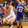 11-10-16<br /> Tri Central vs Tipton girls basketball<br /> Tri Central's Sarah Quesada looks to the basket while Tipton's Gracie Phillips tries to block.<br /> Kelly Lafferty Gerber | Kokomo Tribune