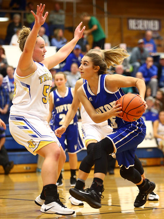 11-10-16<br /> Tri Central vs Tipton girls basketball<br /> Tipton's Rachael Ressler looks past Tri Central's Jaide Cassity to the basket.<br /> Kelly Lafferty Gerber   Kokomo Tribune