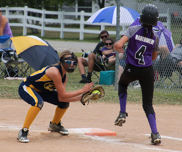 CHRISTY LEGAZA/CHRONICLE Synergy's Abby Viancort makes the grab in time to get Vermilion's Hallie Habermehl out at first.