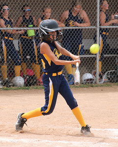 CHRISTY LEGEZA/CHRONICLE Synergy's Mary Lewis takes a swing in the State Championship game.