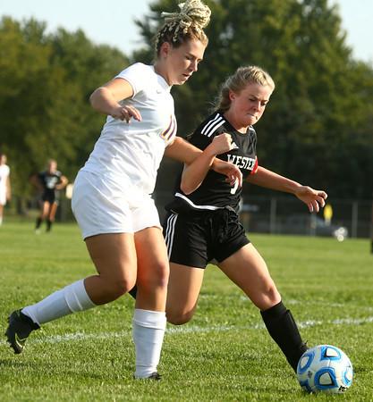 10-6-16<br /> Western vs Marion girls soccer<br /> Western's Emma Harbaugh and Marion's Katie Murphy battle over the ball.<br /> Kelly Lafferty Gerber | Kokomo Tribune