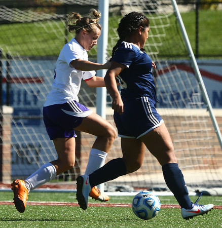 10-8-16<br /> Northwestern vs Lafayette Central Catholic girls soccer sectional<br /> Northwestern's Cate Hale and LCC's Sheyra Pumarino<br /> Kelly Lafferty Gerber | Kokomo Tribune
