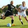 10-6-16<br /> Western vs Marion girls soccer<br /> Western's Samantha Garber kicks the ball before Marion's Ellie Vermillion can get to it.<br /> Kelly Lafferty Gerber | Kokomo Tribune
