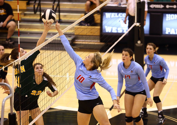 10-18-16<br /> Maconaquah vs Benton Central volleyball<br /> Cassidy Miles tips the ball over the net.<br /> Kelly Lafferty Gerber | Kokomo Tribune
