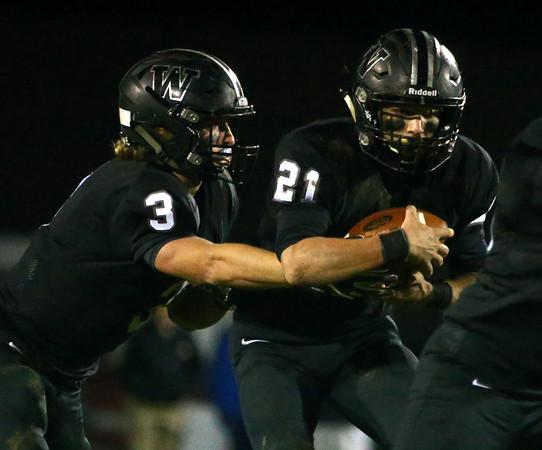 10-21-16<br /> Western vs Mooresville football<br /> Tyler Knepley hands off to Kitchel Gifford.<br /> Kelly Lafferty Gerber   Kokomo Tribune