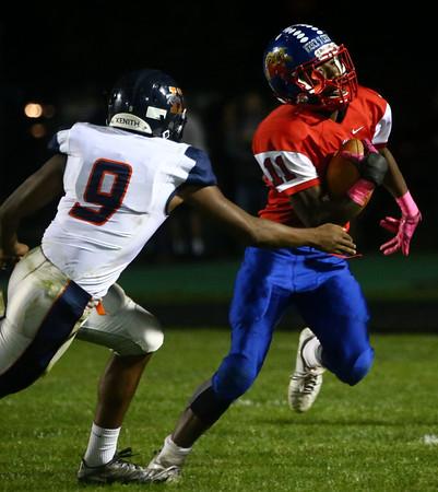 10-7-16<br /> Kokomo vs Harrison football<br /> Steven Edwards tries to outrun Harrison.<br /> Kelly Lafferty Gerber   Kokomo Tribune