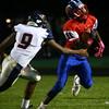 10-7-16<br /> Kokomo vs Harrison football<br /> Steven Edwards tries to outrun Harrison.<br /> Kelly Lafferty Gerber | Kokomo Tribune