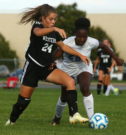 10-4-16<br /> Western vs Kokomo girls soccer<br /> Western's Taylor Kuhns and Kokomo's Elizabeth Patterson battle over control of the ball.<br /> Kelly Lafferty Gerber   Kokomo Tribune