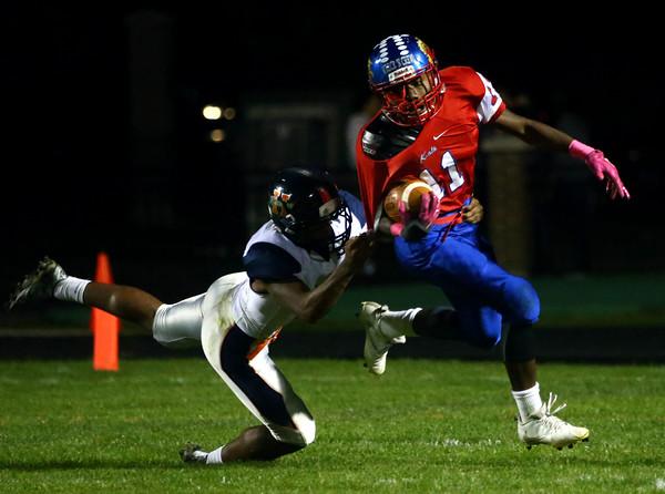 10-7-16<br /> Kokomo vs Harrison football<br /> Kokomo's Steven Edwards tries to outrun Harrison.<br /> Kelly Lafferty Gerber   Kokomo Tribune