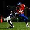 10-7-16<br /> Kokomo vs Harrison football<br /> Kokomo's Steven Edwards tries to outrun Harrison.<br /> Kelly Lafferty Gerber | Kokomo Tribune