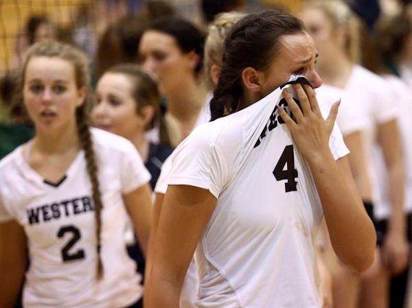 10-22-16<br /> Western vs Benton Central sectional vball championship<br /> Bailey Cook wipes her eyes after Western loses the sectional championship.<br /> Kelly Lafferty Gerber | Kokomo Tribune