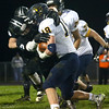 10-21-16<br /> Western vs Mooresville football<br /> Gabe Stewart takes down Mooresville's Josh Brandford.<br /> Kelly Lafferty Gerber | Kokomo Tribune