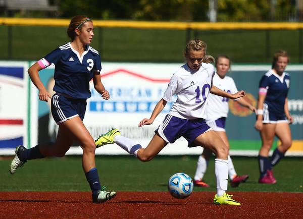 10-8-16<br /> Northwestern vs Lafayette Central Catholic girls soccer sectional<br /> Northwestern's Kailey Kidwell makes the kick before LCC's Emma Gerrety gets to the ball.<br /> Kelly Lafferty Gerber   Kokomo Tribune