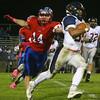 10-7-16<br /> Kokomo vs Harrison football<br /> Harrison's Dawson Dahnke outruns Kokomo's Luke Cameron.<br /> Kelly Lafferty Gerber | Kokomo Tribune