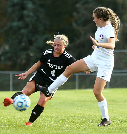 10-6-16<br /> Western vs Marion girls soccer<br /> Western's Faith Lytle and Marion's Abby Eltzroth battle over control of the ball.<br /> Kelly Lafferty Gerber | Kokomo Tribune