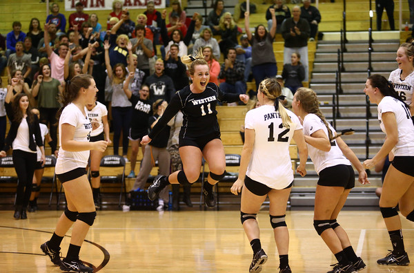 10-20-16<br /> Western vs Northwestern sectional volleyball<br /> Western's Emily Jones jumps into the air as she celebrates Western's victory with her teammates.<br /> Kelly Lafferty Gerber | Kokomo Tribune
