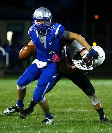 10-14-16<br /> Carroll vs Sheridan football<br /> Carroll's Brandt McClain drags Sheridan's Gunnar Williams along as McClain carries the ball.<br /> Kelly Lafferty Gerber | Kokomo Tribune