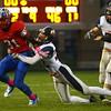 10-7-16<br /> Kokomo vs Harrison football<br /> Kokomo's Keenen Wheeler tries to get out of the grasp of Harrison's Daasch Pearson.<br /> Kelly Lafferty Gerber | Kokomo Tribune