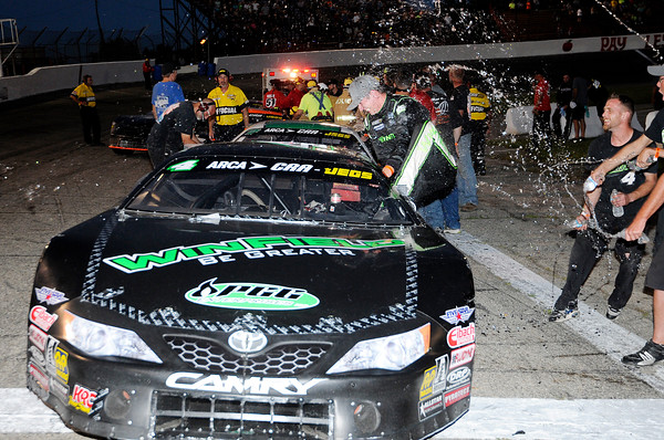 Don Knight   The Herald Bulletin<br /> Dalton Armstrong is sprayed with water by his crew as he climbs out of his car after winning the the Redbud 300 on Saturday.