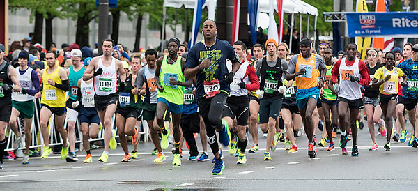 The leaders take off at the beginning of the 2016 Rite Aid Cleveland Marathon. It was announced there were more than 15,000 participants in the 10k, half and full marathon races. The eventual winner of the full marathon, Philemon Terer, is number 53 near the right side of the photograph. BILL KEATON/CHRONICLE