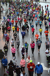 Runners pour along the course shortly after the 7 a.m. start of the 2016 Rite Aid Cleveland Marathon on Sunday morning in near freezing weather. Temperatures were in the 30s at the start of the race, and many finished the 10k, half and full marathon races in a mixture of sleet and hail. BILL KEATON/CHRONICLE