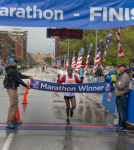 Philemon Terer, of Kenya, crosses the finish line to win the 2016 Rite Aid Cleveland Marathon. The race started with temperatures in the 30s, and Terer finished the race in a mix of sleet and hail. BILL KEATON/CHRONICLE