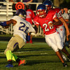 9-2-16<br /> Kokomo vs Marion football<br /> Jake Plump pulls down Marion's 21.<br /> Kelly Lafferty Gerber | Kokomo Tribune