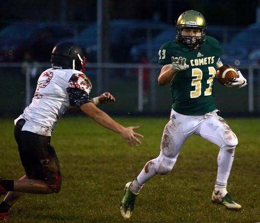 9-30-16<br /> Eastern vs Taylor football<br /> Eastern's Corbin Hetzner outruns Taylor's Mason Cheek.<br /> Kelly Lafferty Gerber   Kokomo Tribune