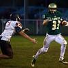 9-30-16<br /> Eastern vs Taylor football<br /> Eastern's Corbin Hetzner outruns Taylor's Mason Cheek.<br /> Kelly Lafferty Gerber | Kokomo Tribune