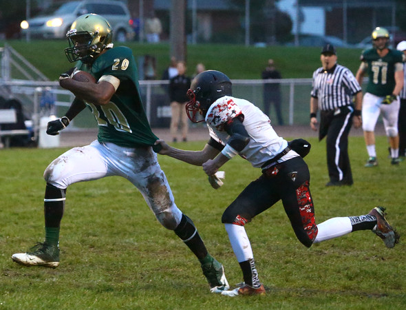 9-30-16<br /> Eastern vs Taylor football<br /> Eastern's Dontae Nolder drags Taylor's Mason Cheek along and scores a touchdown for Eastern.<br /> Kelly Lafferty Gerber   Kokomo Tribune