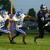 9-23-16<br /> Northwestern vs Tipton football<br /> Northwestern's Trey Richmond tries to outrun Tipton's defense.<br /> Kelly Lafferty Gerber | Kokomo Tribune