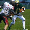 9-30-16<br /> Eastern vs Taylor football<br /> Eastern's Corbin Hetzner tries to outrun Taylor's defense.<br /> Kelly Lafferty Gerber | Kokomo Tribune