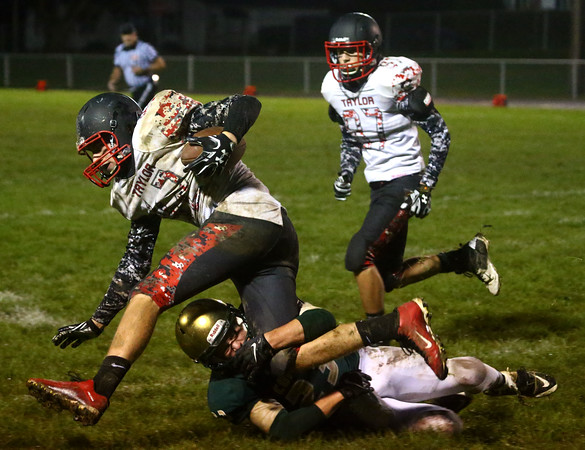 9-30-16<br /> Eastern vs Taylor football<br /> Eastern's Draeden Morris-Graber takes down Taylor's Brayden Hancock.<br /> Kelly Lafferty Gerber   Kokomo Tribune