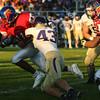 9-2-16<br /> Kokomo vs Marion football<br /> Kokomo's Steven Edwards tries to get away from Marion's Ian Reynolds.<br /> Kelly Lafferty Gerber | Kokomo Tribune