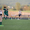 ERHS' Alyssa Wigley finds a hole and moves the ball downfield.
