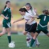 ERHS' Erin Clayton pushes the ball pass Wilson's Kacey Dukes