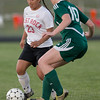 ERHS' Norma Morris  moves the ball past Wilson's Addison Tuttle