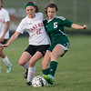 ERHS' Sydney Halleman and WIlson's Keri Sims fight for the ball