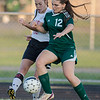 ERHS' Alyssa Wigley defends the ball against Wilson's Sarah Daley