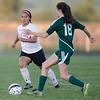 ERHS' Norma Morris  moves the ball past Wilson's Savannah Angel