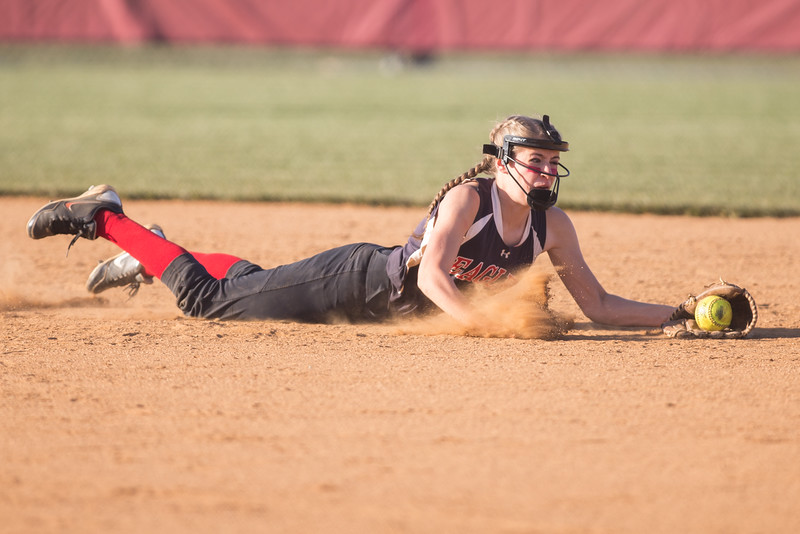 ERHS' Brianna Roach dives to catch a ground ball.