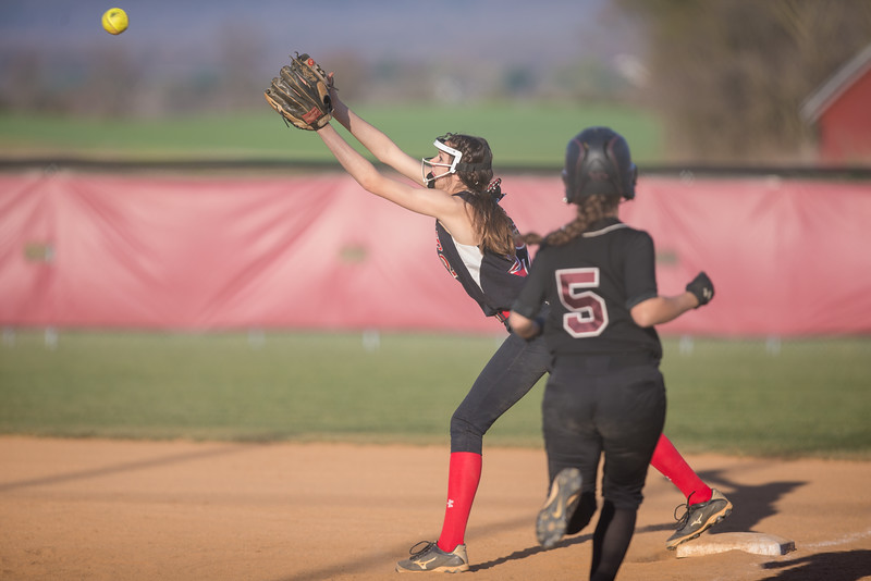ERHS' Nicole Jefferson stretches for a ball at first.