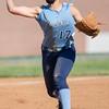 Kate Gordon throws to first base.