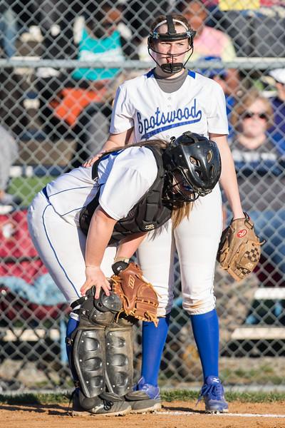 Pitcher Kristen Fletcher checks on catch Haileigh Lutz and being hit by the ball.