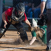 Serenity Bishop attemps to tag  Wilson's Morgan Hughes as she slides in to home.
