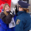 Special to the Record-Eagle/Joanie Moore<br /> Special Olympics athlete Kelly Marshall of Area 27 (Livingston County) receives a medal from Michigan State Police 1st Lt. Jennifer Johnson.  Marshall earned the honors in her division of the Downhill-Alpine ski event at Schuss Village in Mancelona Wednesday.