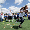 Leominster's Natalia Muniz competes in the Special Olympics at Fitchburg State's Elliot Field on Friday morning. SENTINEL & ENTERPRISE / Ashley Green