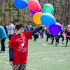 Roman Young, from South Street Elementary, checks out the balloons during the Special Olympics at Fitchburg State's Elliot Field on Friday morning. SENTINEL & ENTERPRISE / Ashley Green