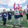 Rosie Fortunato celebrates after throwing a football through a hoop during the Special Olympics at Fitchburg State's Elliot Field on Friday morning. SENTINEL & ENTERPRISE / Ashley Green